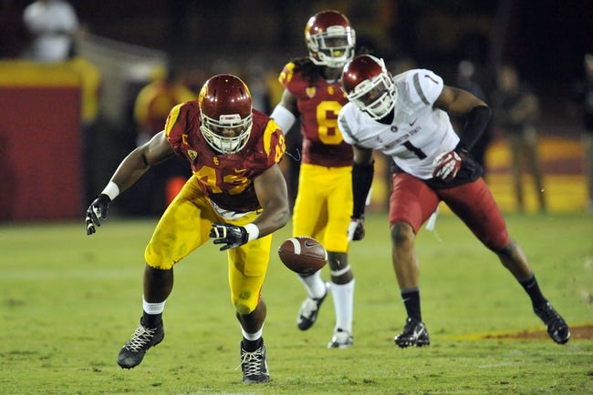 September 7, 2013; Los Angeles, CA, USA; Southern California Trojans linebacker Devon Kennard (42) nearly intercepts a pass against the Washington State Cougars during the second half at the Los Angeles Memorial Coliseum. Mandatory Credit: Gary A. Vasquez-USA TODAY Sports