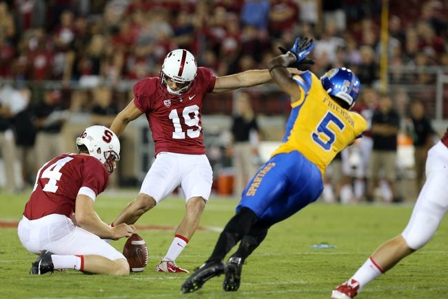 Sep 7, 2013; Stanford, CA, USA; Stanford Cardinal kicker Jordan Williamson (19) kicks the field goal with the hold by punter Ben Rhyne (14) against San Jose State Spartans cornerback Dasheon Frierson (5) during the third quarter at Stanford Stadium. The Stanford Cardinal defeated the San Jose State Spartans 34-13. Mandatory Credit: Kelley L Cox-USA TODAY Sports
