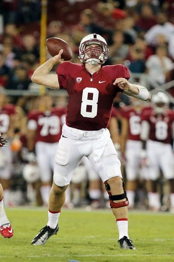 Sep 7, 2013; Stanford, CA, USA; Stanford Cardinal quarterback Kevin Hogan (8) passes the ball against the San Jose State Spartans during the third quarter at Stanford Stadium. The Stanford Cardinal defeated the San Jose State Spartans 34-13. Mandatory Credit: Kelley L Cox-USA TODAY Sports