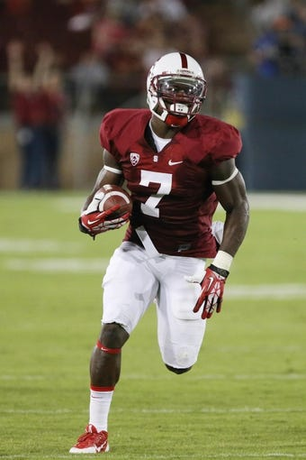 Sep 7, 2013; Stanford, CA, USA; Stanford Cardinal wide receiver Ty Montgomery (7) carries the ball against the San Jose State Spartans during the fourth quarter at Stanford Stadium. The Stanford Cardinal defeated the San Jose State Spartans 34-13. Mandatory Credit: Kelley L Cox-USA TODAY Sports