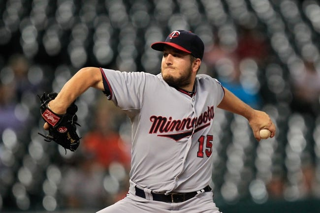 Sep 3, 2013; Houston, TX, USA; Minnesota Twins relief pitcher Glen Perkins (15) pitches against the Houston Astros during the ninth inning at Minute Maid Park. Mandatory Credit: Thomas Campbell-USA TODAY Sports