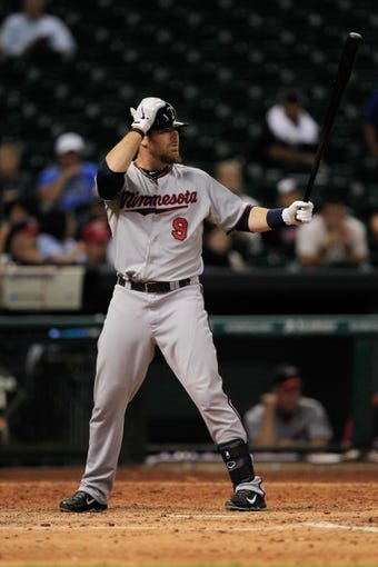 Sep 3, 2013; Houston, TX, USA; Minnesota Twins catcher Ryan Doumit (9) bats against the Houston Astros during the twelfth inning at Minute Maid Park. The Twins won 9-6. Mandatory Credit: Thomas Campbell-USA TODAY Sports