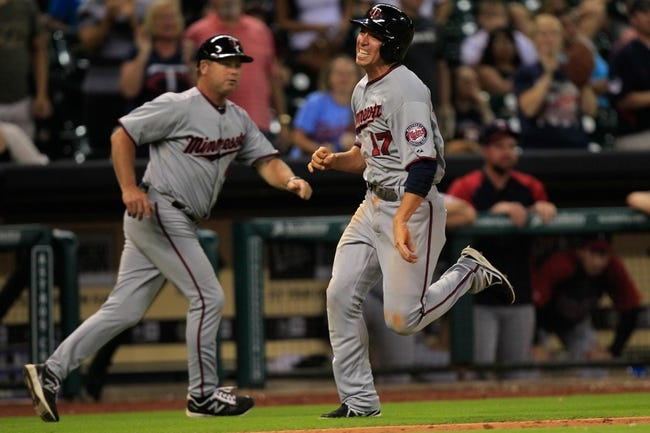 Sep 3, 2013; Houston, TX, USA; Minnesota Twins second baseman Doug Bernier (17) against the Houston Astros during the twelfth inning at Minute Maid Park. The Twins won 9-6. Mandatory Credit: Thomas Campbell-USA TODAY Sports