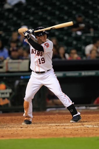 Sep 3, 2013; Houston, TX, USA; Houston Astros left fielder Robbie Grossman (19) bats against the Minnesota Twins during the tenth inning at Minute Maid Park. Mandatory Credit: Thomas Campbell-USA TODAY Sports