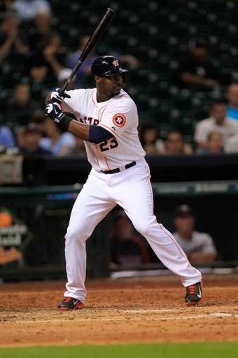 Sep 3, 2013; Houston, TX, USA; Houston Astros left fielder Chris Carter (23) bats against the Minnesota Twins during the ninth inning at Minute Maid Park. Mandatory Credit: Thomas Campbell-USA TODAY Sports