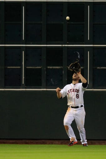 Sep 3, 2013; Houston, TX, USA; Houston Astros left fielder Trevor Crowe (8) catches a fly ball against the Minnesota Twins during the eleventh inning at Minute Maid Park. Mandatory Credit: Thomas Campbell-USA TODAY Sports