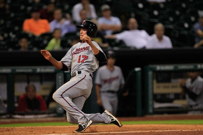 Sep 3, 2013; Houston, TX, USA; Minnesota Twins second baseman Doug Bernier (17) slides home against the Houston Astros during the twelfth inning at Minute Maid Park. The Twins won 9-6. Mandatory Credit: Thomas Campbell-USA TODAY Sports