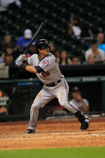Sep 3, 2013; Houston, TX, USA; Minnesota Twins center fielder Darin Mastroianni (19) bats against the Houston Astros during the tenth inning at Minute Maid Park. Mandatory Credit: Thomas Campbell-USA TODAY Sports