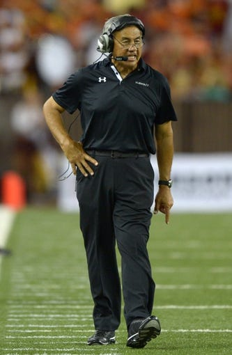 Aug 29, 2013; Honolulu, HI, USA; Hawaii Rainbow Warriors coach Norm Chow reacts during the game against the Southern California Trojans at Aloha Stadium. USC defeated Hawaii 30-13. Mandatory Credit: Kirby Lee-USA TODAY Sports
