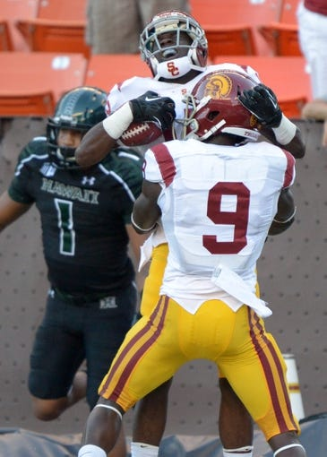 Aug 29, 2013; Honolulu, HI, USA; Southern California Trojans receiver Nelson Agholor (15) celebrates with receiver Marqise Lee (9) after scoring on a 19-yard touchdown pass in the second quarter against the Hawaii Rainbow Warriors at Aloha Stadium. Mandatory Credit: Kirby Lee-USA TODAY Sports