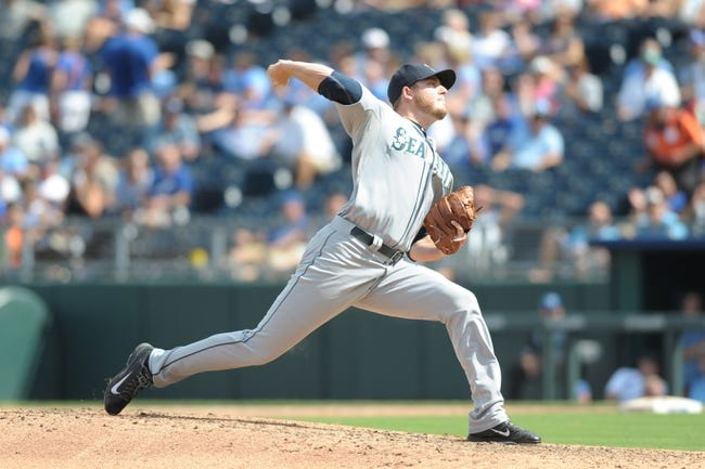 Sep 5, 2013; Kansas City, MO, USA; Seattle Mariners relief pitcher Charlie Furbush (41) delivers a pitch during the game against the Kansas City Royals at Kauffman Stadium. The Royals won 7-6. Mandatory Credit: Denny Medley-USA TODAY Sports