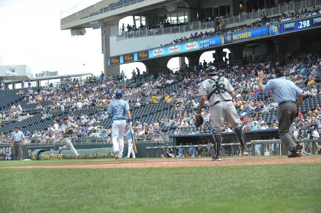 Sep 5, 2013; Kansas City, MO, USA; Seattle Mariners first baseman Justin Smoak (17) fields a foul ball hit by Kansas City Royals first baseman Eric Hosmer (35) in the game at Kauffman Stadium. The Royals won 7-6. Mandatory Credit: Denny Medley-USA TODAY Sports