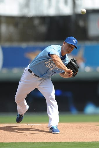 Sep 5, 2013; Kansas City, MO, USA; Kansas City Royals starting pitcher Danny Duffy (41) delivers a warm up pitch before the game against the Seattle Mariners at Kauffman Stadium. The Royals won 7-6. Mandatory Credit: Denny Medley-USA TODAY Sports