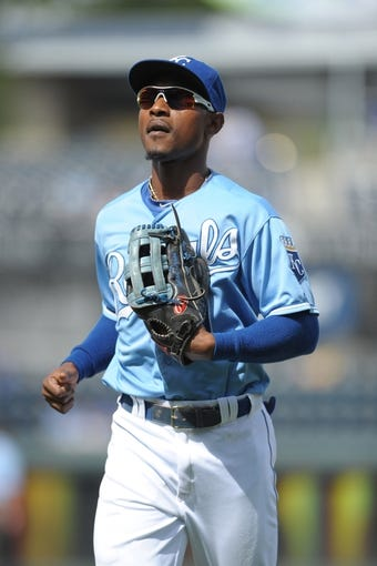 Sep 5, 2013; Kansas City, MO, USA; Kansas City Royals center fielder Jarrod Dyson (1) returns to the dugout in between innings of the game against the Seattle Mariners at Kauffman Stadium. The Royals won 7-6. Mandatory Credit: Denny Medley-USA TODAY Sports