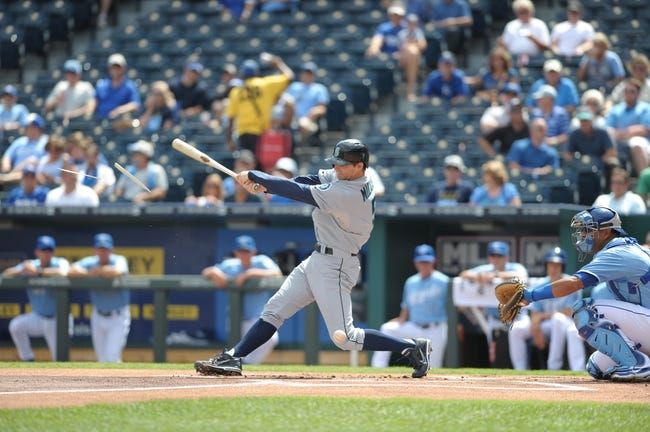 Sep 5, 2013; Kansas City, MO, USA; Seattle Mariners shortstop Brad Miller (5) breaks his bat in the first inning of the game against the Kansas City Royals at Kauffman Stadium. The Royals won 7-6. Mandatory Credit: Denny Medley-USA TODAY Sports