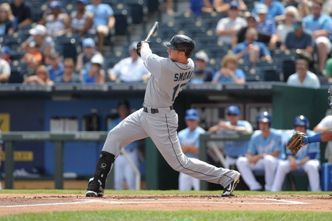 Sep 5, 2013; Kansas City, MO, USA; Seattle Mariners first baseman Justin Smoak (17) connects for a home run in the first inning of the game against the Kansas City Royals at Kauffman Stadium. The Royals won 7-6. Mandatory Credit: Denny Medley-USA TODAY Sports