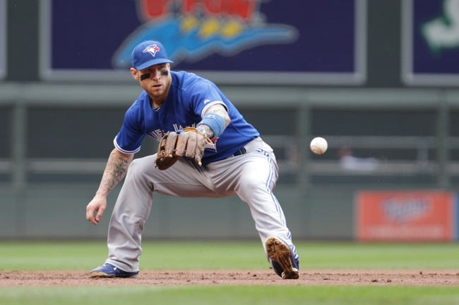 Sep 8, 2013; Minneapolis, MN, USA; Toronto Blue Jays third baseman Brett Lawrie fields the ground ball during the first inning against Minnesota Twins at Target Field.  Mandatory Credit: Brad Rempel-USA TODAY Sports