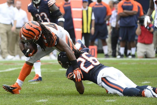Sep 8, 2013; Chicago, IL, USA;  Cincinnati Bengals running back BenJarvus Green-Ellis (42) rushes the ball against Chicago Bears cornerback Tim Jennings (26) during the fourth quarter at Soldier Field. Chicago defeats Cincinnati 24-21. Mandatory Credit: Mike DiNovo-USA TODAY Sports