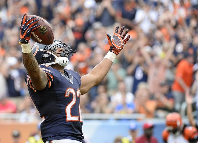 Sep 8, 2013; Chicago, IL, USA; Chicago Bears running back Matt Forte (22) reacts after scoring a touchdown against the Cincinnati Bengals during the fourth quarter at Soldier Field. Chicago defeats Cincinnati 24-21. Mandatory Credit: Mike DiNovo-USA TODAY Sports
