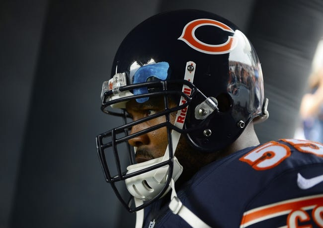 Sep 8, 2013; Chicago, IL, USA; Chicago Bears outside linebacker Lance Briggs (55) takes the field against the Cincinnati Bengals at Soldier Field. Chicago defeats Cincinnati 24-21. Mandatory Credit: Mike DiNovo-USA TODAY Sports