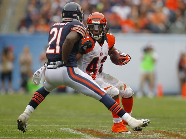 Sep 8, 2013; Chicago, IL, USA; Cincinnati Bengals running back BenJarvus Green-Ellis (42) is defended by Chicago Bears strong safety Major Wright (21) during the second half at Soldier Field. Chicago won 24-21. Mandatory Credit: Dennis Wierzbicki-USA TODAY Sports