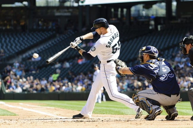 Sep 8, 2013; Seattle, WA, USA; Seattle Mariners left fielder Michael Saunders (55) hits a single against the Tampa Bay Rays during the 2nd inning at Safeco Field. Mandatory Credit: Steven Bisig-USA TODAY Sports