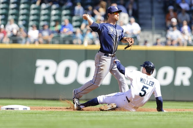 Sep 8, 2013; Seattle, WA, USA; Tampa Bay Rays shortstop Ben Zobrist (18) turns the double play with Seattle Mariners shortstop Brad Miller (5) sliding into 2nd base during the 1st inning at Safeco Field. Mandatory Credit: Steven Bisig-USA TODAY Sports