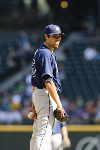 Sep 8, 2013; Seattle, WA, USA; Tampa Bay Rays starting pitcher Matt Moore (55) during the 1st inning against the Seattle Mariners at Safeco Field. Mandatory Credit: Steven Bisig-USA TODAY Sports