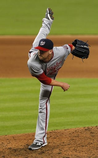 Sep 8, 2013; Miami, FL, USA; Washington Nationals relief pitcher Drew Storen (22) follows through a pitch against the Miami Marlins in the seventh inning at Marlins Park. The Nationals won 6-4. Mandatory Credit: Robert Mayer-USA TODAY Sports