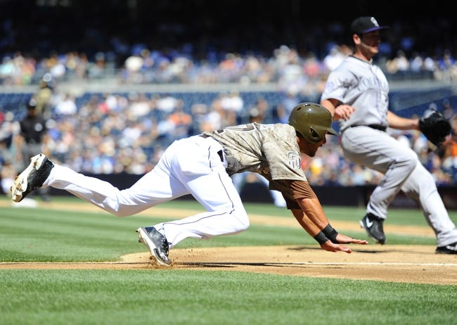 Sep 8, 2013; San Diego, CA, USA; San Diego Padres center fielder Reymond Fuentes (27) tries to score on a passed ball during the third inning against the Colorado Rockies at Petco Park. Mandatory Credit: Christopher Hanewinckel-USA TODAY Sports