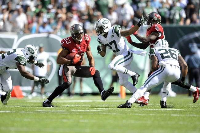 Sep 8, 2013; East Rutherford, NJ, USA; Tampa Bay Buccaneers wide receiver Vincent Jackson (83) runs after a catch against the New York Jets during the second half at MetLife Stadium. The Jets won 18-17. Mandatory Credit: Joe Camporeale-USA TODAY Sports