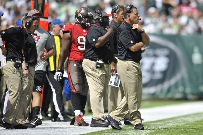 Sep 8, 2013; East Rutherford, NJ, USA; Tampa Bay Buccaneers head coach Greg Schiano (right) and his coaching staff look on against the New York Jets during the first half at MetLife Stadium. The Jets won 18-17. Mandatory Credit: Joe Camporeale-USA TODAY Sports
