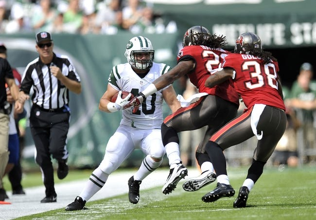 Sep 8, 2013; East Rutherford, NJ, USA; New York Jets fullback Tommy Bohanon (40) runs after a catch against the Tampa Bay Buccaneers during the first half at MetLife Stadium. The Jets won 18-17. Mandatory Credit: Joe Camporeale-USA TODAY Sports