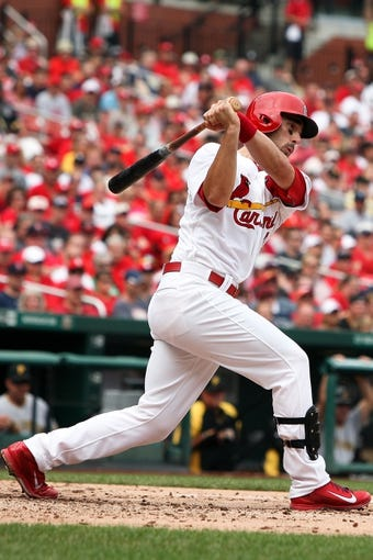Sep 8, 2013; St. Louis, MO, USA; St. Louis Cardinals second baseman Matt Carpenter (13) hits for an RBI double in the second inning against the Pittsburgh Pirates at Busch Stadium. Mandatory Credit: Scott Kane-USA TODAY Sports