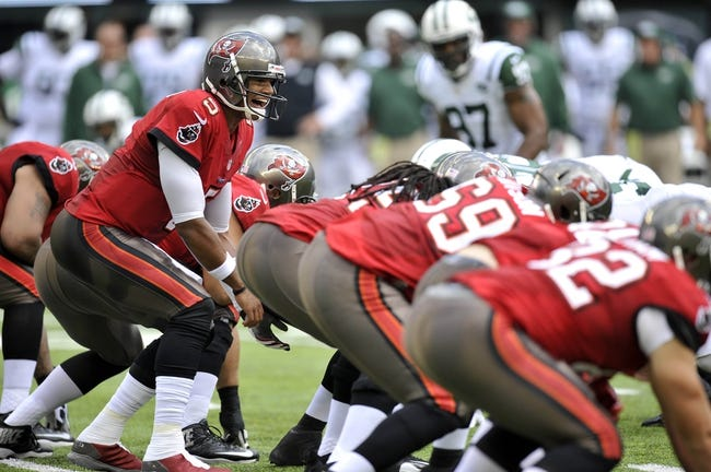 Sep 8, 2013; East Rutherford, NJ, USA; Tampa Bay Buccaneers quarterback Josh Freeman (5) calls signals at the line of scrimmage against the New York Jets during the first half at MetLife Stadium. The Jets won 18-17. Mandatory Credit: Joe Camporeale-USA TODAY Sports