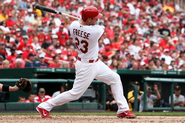 Sep 8, 2013; St. Louis, MO, USA;  St. Louis Cardinals third baseman David Freese (23) hits a RBI single in the fifth inning against the Pittsburgh Pirates at Busch Stadium. Mandatory Credit: Scott Kane-USA TODAY Sports
