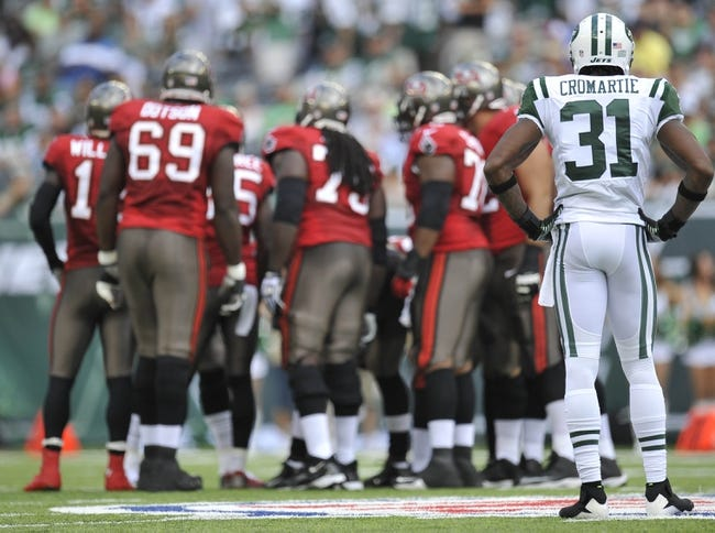 Sep 8, 2013; East Rutherford, NJ, USA; New York Jets cornerback Antonio Cromartie (31) looks on as the Tampa Bay Buccaneers huddle during the first half at MetLife Stadium. The Jets won 18-17. Mandatory Credit: Joe Camporeale-USA TODAY Sports