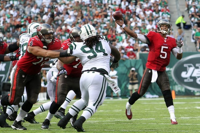 Sep 8, 2013; East Rutherford, NJ, USA; Tampa Bay Buccaneers quarterback Josh Freeman (5) drops back to pass against the New York Jets during the first quarter of a game at MetLife Stadium. The Jets won 18-17. Mandatory Credit: Brad Penner-USA TODAY Sports