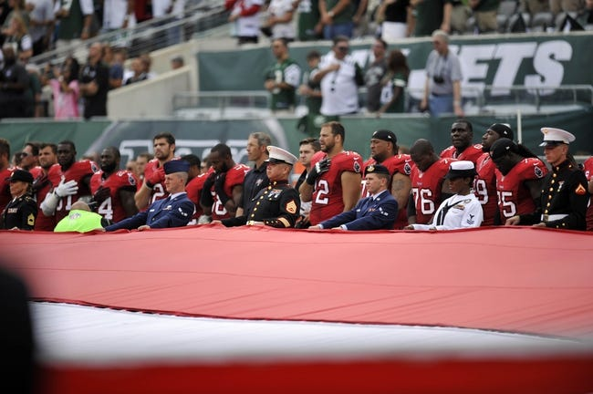 Sep 8, 2013; East Rutherford, NJ, USA; Color guards look on before the first half of the Tampa Bay Buccaneers and New York Jets game at MetLife Stadium. The Jets won 18-17. Mandatory Credit: Joe Camporeale-USA TODAY Sports
