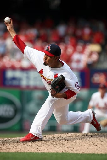 Sep 8, 2013; St. Louis, MO, USA; St. Louis Cardinals relief pitcher Fernando Salas (59) pitches in the ninth inning against the Pittsburgh Pirates at Busch Stadium. Mandatory Credit: Scott Kane-USA TODAY Sports