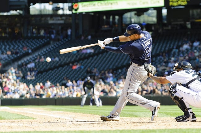 Sep 8, 2013; Seattle, WA, USA; Tampa Bay Rays first baseman James Loney (21) hits a single against the Seattle Mariners during the 4th inning at Safeco Field. Mandatory Credit: Steven Bisig-USA TODAY Sports