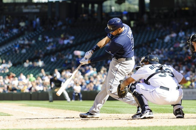 Sep 8, 2013; Seattle, WA, USA; Tampa Bay Rays first baseman James Loney (21) hits a single against the Seattle Mariners during the 6th inning at Safeco Field. Mandatory Credit: Steven Bisig-USA TODAY Sports