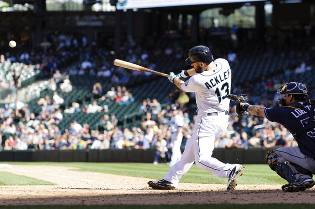 Sep 8, 2013; Seattle, WA, USA; Seattle Mariners second baseman Dustin Ackley (13) hits a single against the Tampa Bay Rays during the 7th inning at Safeco Field. Mandatory Credit: Steven Bisig-USA TODAY Sports