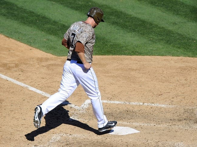 Sep 8, 2013; San Diego, CA, USA; San Diego Padres third baseman Chase Headley (7) scores on a walk to tie the game during the seventh inning against the Colorado Rockies at Petco Park. Mandatory Credit: Christopher Hanewinckel-USA TODAY Sports
