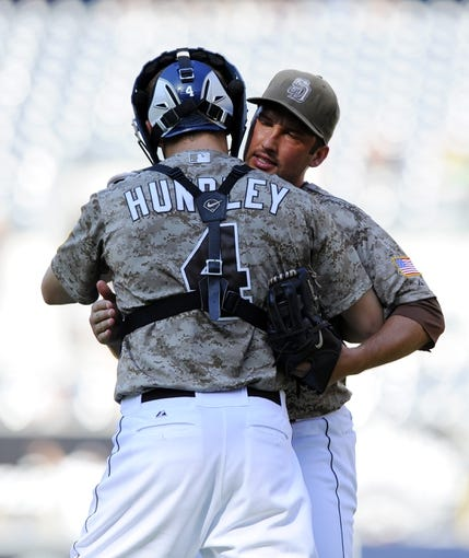 Sep 8, 2013; San Diego, CA, USA; San Diego Padres relief pitcher Huston Street (16) celebrates with catcher Nick Hundley (4) after a win against the Colorado Rockies at Petco Park. The Padres won 5-2. Mandatory Credit: Christopher Hanewinckel-USA TODAY Sports