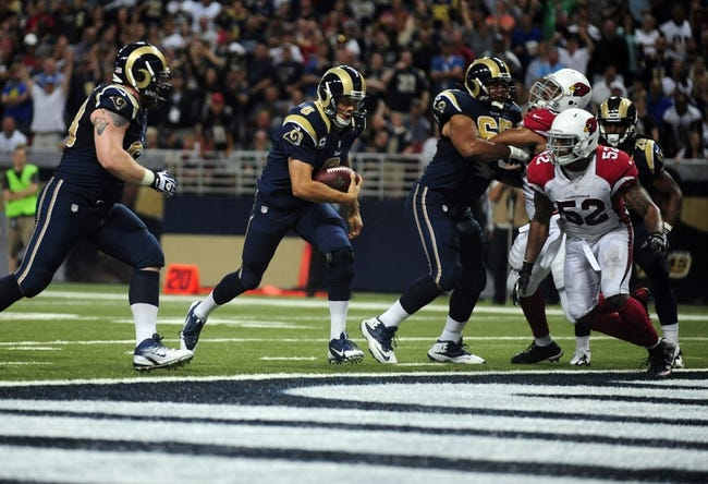 Sep 8, 2013; St. Louis, MO, USA; St. Louis Rams quarterback Sam Bradford (8) runs in for a two point conversion against the Arizona Cardinals during the second half at Edward Jones Dome. St. Louis defeated Arizona 27-24. Mandatory Credit: Jeff Curry-USA TODAY Sports