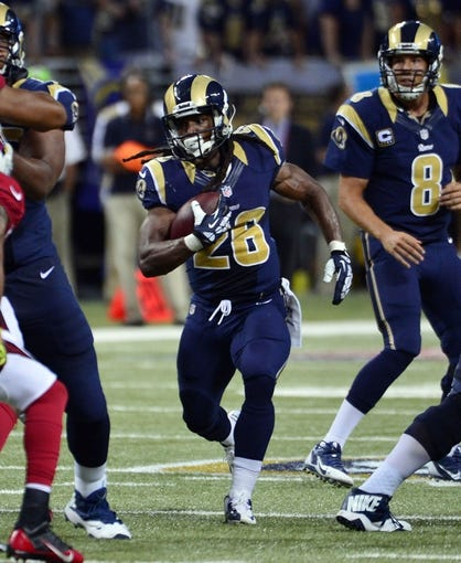 Sep 8, 2013; St. Louis, MO, USA; St. Louis Rams running back Daryl Richardson (26) rushes against the Arizona Cardinals during the second half at Edward Jones Dome. The Rams defeated the Cardinals 27-24. Mandatory Credit: Scott Rovak-USA TODAY Sports