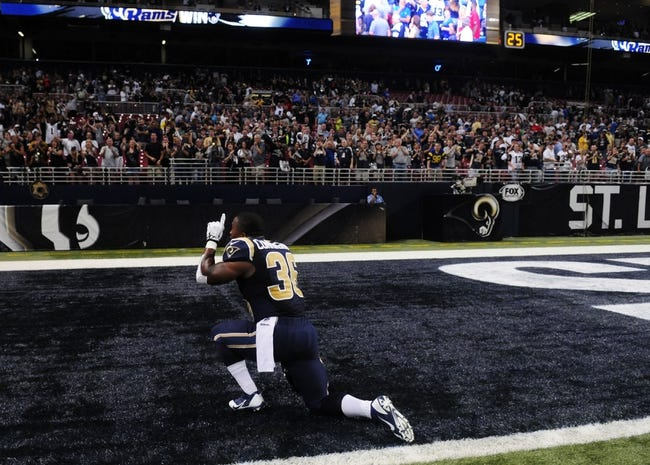 Sep 8, 2013; St. Louis, MO, USA; St. Louis Rams running back Benny Cunningham (36) after defeating the Arizona Cardinals at Edward Jones Dome. St. Louis defeated Arizona 27-24. Mandatory Credit: Jeff Curry-USA TODAY Sports
