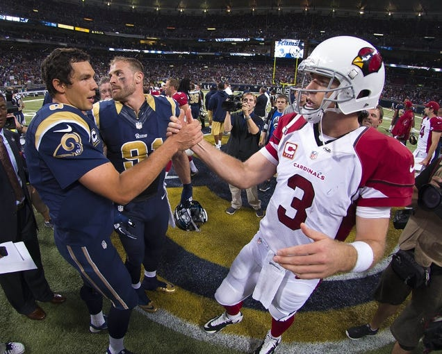 Sep 8, 2013; St. Louis, MO, USA; Arizona Cardinals quarterback Carson Palmer (3) congratulates St. Louis Rams quarterback Sam Bradford (8) after the game at Edward Jones Dome. The Rams defeated the Cardinals 27-24. Mandatory Credit: Scott Rovak-USA TODAY Sports