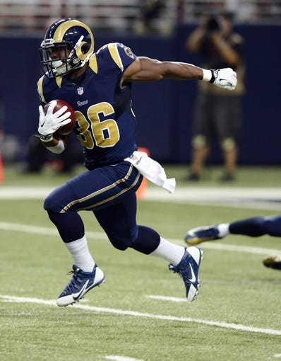 Sep 8, 2013; St. Louis, MO, USA; St. Louis Rams running back Benny Cunningham (36) returns a kick off during the second half against the Arizona Cardinals at Edward Jones Dome. St. Louis defeated Arizona 27-24. Mandatory Credit: Jeff Curry-USA TODAY Sports